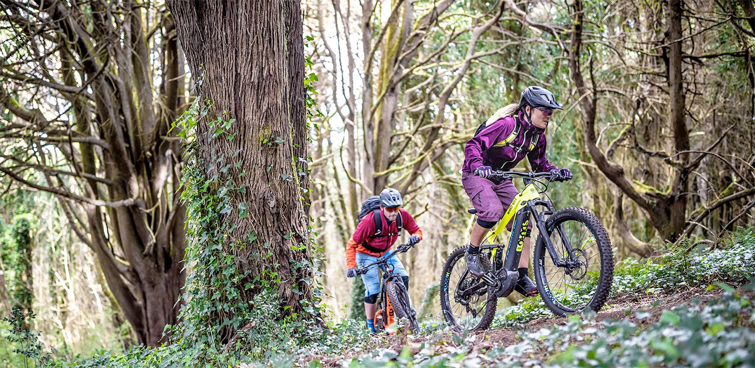 Couple riding their Haibike EBIKE's through a forest
